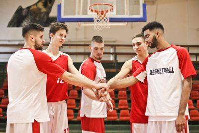 group of people basketball handshake